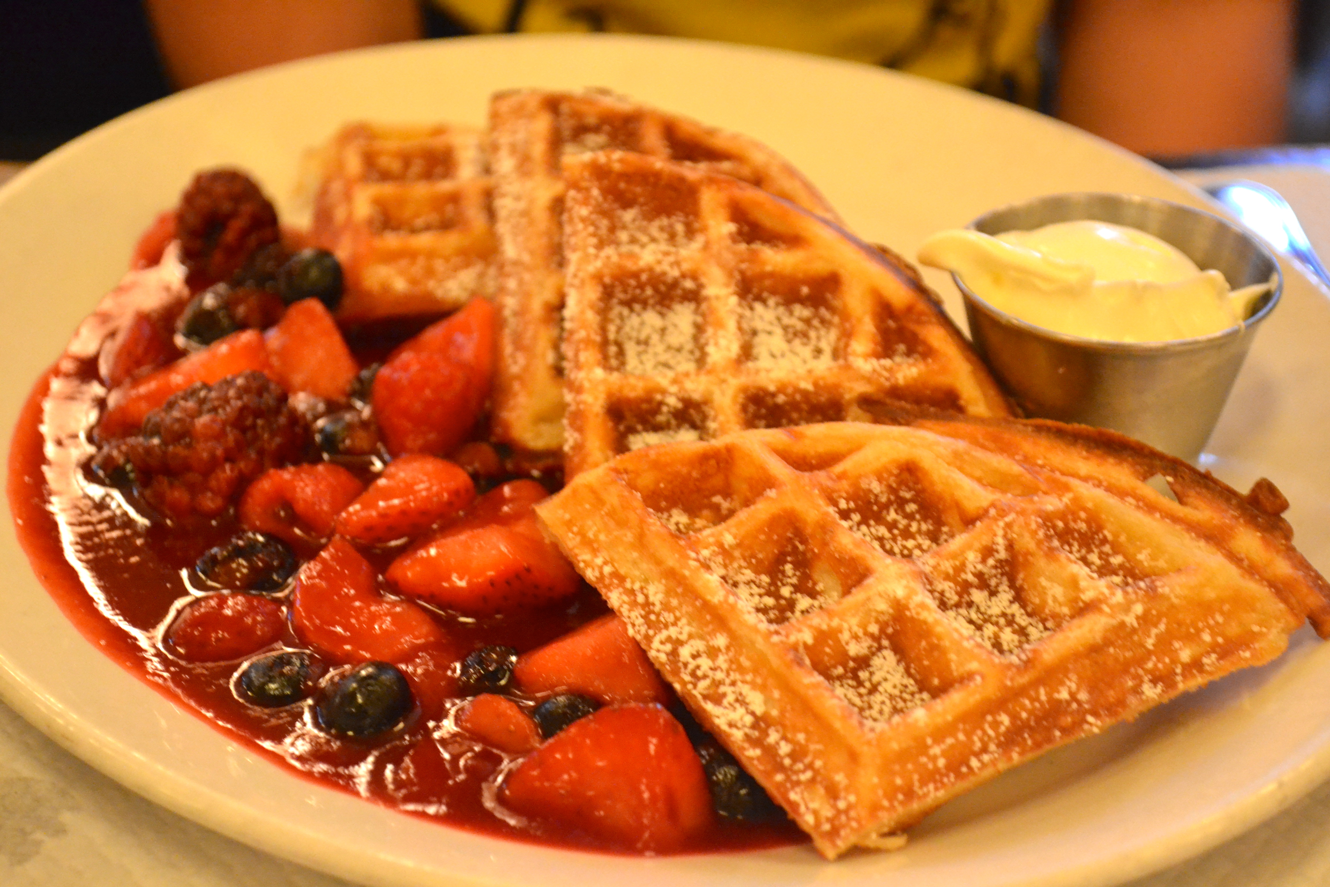 We also shared the sour cream hazelnut waffles with warm berries, also ...