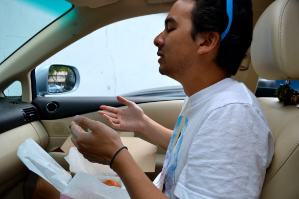 Eating Malasadas in the Car