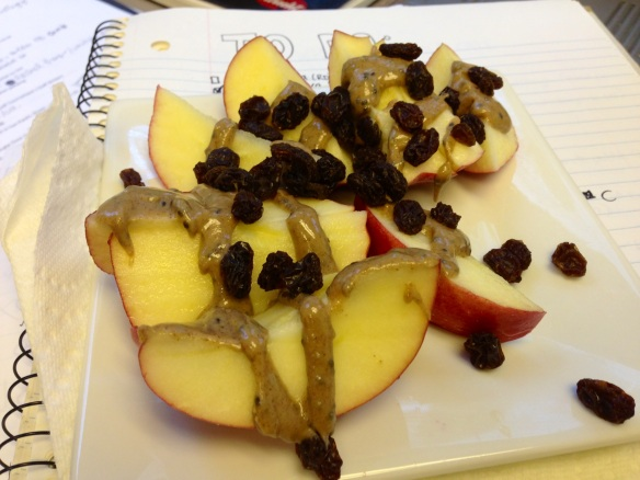 Apples with almond butter and raisins